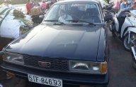 Cần bán gấp Toyota Corona đời 1985, màu đen, xe nhập giá 89 triệu tại Vĩnh Long