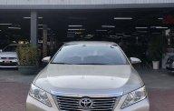 Cần bán Toyota Camry đời 2013, màu vàng giá 670 triệu tại Tp.HCM