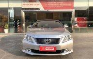 Cần bán Toyota Camry 2.0E AT đời 2013, màu bạc xe gia đình giá 665 triệu tại Tp.HCM