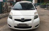 Bán xe gia đình giá rẻ với chiếc Toyota Yaris sản xuất 2009, màu trắng, nhập khẩu giá 330 triệu tại Hà Nội