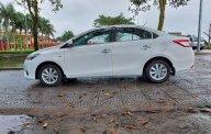 Gia đình cần bán Toyota Vios sản xuất 2014, màu trắng, mới đi được 10.000km giá 305 triệu tại Hải Dương