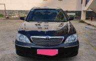 Cần bán Toyota Camry 2004, màu đen, nhập khẩu nguyên chiếc   giá 310 triệu tại Tp.HCM