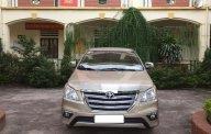 Cần bán Toyota Innova 2.0E đời 2016, màu vàng, chính chủ giá 415 triệu tại Hà Nội