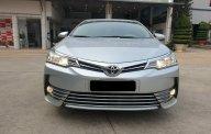 Cần bán xe Toyota Altis 1.8G AT 2018 màu bạc, xe đi ít giữ kĩ chính hãng Toyota Sure giá 700 triệu tại Tp.HCM