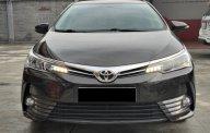 Bán xe Toyota Altis 1.8G CVT 2019 màu đen, xe đẹp đi kĩ giá 700 triệu tại Tp.HCM