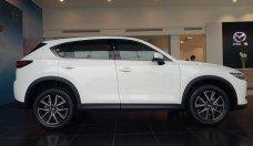 Bán CX-5 2.5 1 cầu màu trắng, có xe giao ngay trong 3 ngày, hỗ trợ vay ngân hàng 90%. Lh 0931 886936 Thịnh Mazda giá 999 triệu tại Tp.HCM