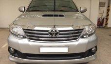 Bán xe Toyota Fortuner G năm 2014, màu bạc, hỗ trợ giá tốt giá 865 triệu tại Tp.HCM