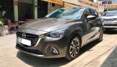 Bán Mazda 2 AT sản xuất năm 2016, màu nâu xe gia đình giá 500 triệu tại Tp.HCM