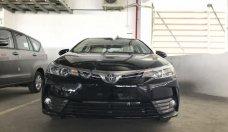 Bán ô tô Toyota Corolla altis 1.8E AT đời 2018, màu đen giá 680 triệu tại Tp.HCM