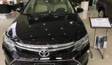 Cần bán Toyota Camry 2.0E năm sản xuất 2018, màu đen, giá 980tr giá 980 triệu tại Tp.HCM