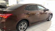 Cần bán gấp Toyota Corolla Altis 1.8G AT sản xuất năm 2015, màu nâu chính chủ giá 668 triệu tại Hải Phòng