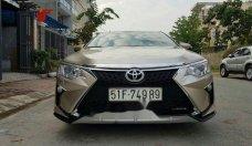 Bán Toyota Camry 2016, màu vàng cát giá 940 triệu tại Tp.HCM
