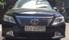 Cần bán xe Toyota Camry 2.0 E đời 2012, chính chủ, màu đen giá 750 triệu tại Tp.HCM
