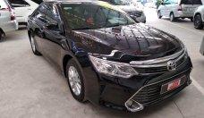 Bán xe Toyota Camry E SX 2015, màu đen, giá thương lượng, hỗ trợ trả góp giá 923 triệu tại Tp.HCM