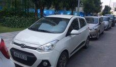 Chính chủ bán Hyundai Grand i10 1.2 AT sản xuất 2015, màu trắng giá 395 triệu tại Hà Nội