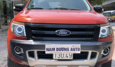 Bán xe Ford Ranger Wildtrak 2.2AT đời 2014 màu cam, giá tốt, nhập khẩu nguyên chiếc giá 625 triệu tại Hà Nội