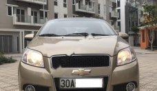 Cần bán gấp Chevrolet Aveo 1.5MT sản xuất 2014, màu vàng xe gia đình giá 298 triệu tại Hà Nội