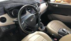 Cần bán gấp Hyundai Grand i10 1.0MT sản xuất năm 2014, màu trắng còn mới, giá 299tr giá 299 triệu tại Đắk Lắk