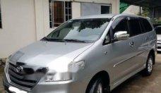 Cần bán gấp Toyota Innova 2.0E đời 2014, màu bạc xe gia đình giá 560 triệu tại Bình Dương