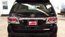 Cần bán Toyota Fortuner 2.7V 4x2 đời 2015, màu đen giá 850 triệu tại Tp.HCM