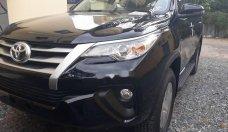 Bán Toyota Fortuner 2.4G 4x2 MT đời 2018, màu đen giá 1 tỷ 26 tr tại Tp.HCM