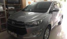 Cần bán gấp Toyota Innova E sản xuất 2016, màu bạc chính chủ  giá 698 triệu tại Tp.HCM