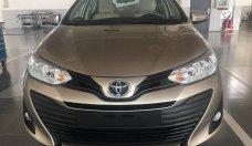 Bán xe Toyota Vios 1.5E CVT màu nâu, tặng gói bảo dưỡng 20.000km, hỗ trợ vay lên tới 90% giá trị xe, lh: 0912493498 giá 569 triệu tại Tp.HCM