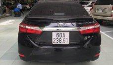 Cần bán Toyota Corolla Altis 1.8 AT 2015, odo 72.000km, màu đen, đủ đồ chơi giá 635 triệu tại Tp.HCM