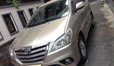 Cần bán xe Toyota Innova 2.0G AT 2014 màu vàng cát giá 585 triệu tại Tp.HCM