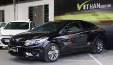 Bán xe Kia Cerato 1.6MT đời 2016, màu đen, giá tốt giá 498 triệu tại Tp.HCM