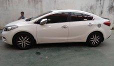 Gia đình cần bán xe Kia K3 2015 màu trắng giá 550 triệu tại Tp.HCM
