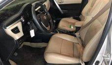 Cần bán Toyota Corolla altis 1.8G MT 2016, màu bạc số sàn, giá 665tr giá 665 triệu tại Tp.HCM