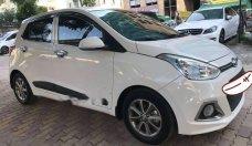 Bán Hyundai Grand i10 1.2AT sản xuất năm 2015, màu trắng số tự động, giá chỉ 385 triệu giá 385 triệu tại Hà Nội