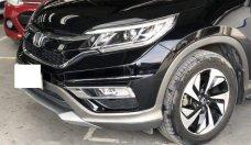 Gia đình bán ô tô Honda CR V 2.4AT đời 2014, màu đen giá 856 triệu tại Tp.HCM