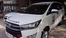 Bán xe Toyota Innova E 2.0MT sản xuất năm 2016, màu trắng số sàn giá 688 triệu tại Tp.HCM