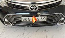 Bán Toyota Camry 2.0E năm 2015, màu đen như mới giá 870 triệu tại Hà Nội