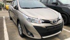 Bán xe Toyota Vios 1.5E CVT đời 2018, màu vàng giá 569 triệu tại Tp.HCM