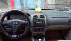 Cần bán Mazda 323 sản xuất 2003, màu đen, nhập khẩu chính chủ, giá chỉ 145 triệu giá 145 triệu tại Vĩnh Phúc