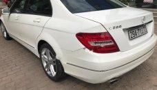 Cần bán Mercedes C200 sản xuất 2012, màu trắng chính chủ giá 710 triệu tại Hà Nội