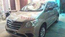Gia đình bán xe Toyota Innova 2.0E MT năm 2014, màu vàng cát giá 560 triệu tại Hà Nội