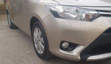 Cần bán xe Toyota Vios 2017 bản E số tự động. Xe màu vàng cát giá 545 triệu tại Tp.HCM