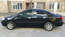 Bán xe Toyota Corolla Altis, màu đen, đời 2004, số tay, nhiên liệu 7 lít, mới đi 12,0000 km giá 290 triệu tại Hà Nội