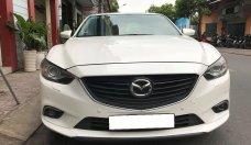 Gia đình cần bán Mazda 6 sản xuất 2016, số tự động, bản 2.0, màu trắng giá 696 triệu tại Tp.HCM