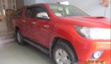 Bán Toyota Hilux 3.0G đời 2016, màu đỏ, số sàn  giá 650 triệu tại Tp.HCM