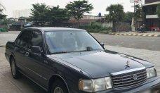 Gia đình bán Toyota Crown năm sản xuất 1994, xe nhập, màu xanh xám giá 230 triệu tại Tp.HCM