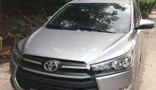 Cần bán gấp Toyota Innova 2.0E đời 2018, màu bạc xe gia đình  giá 730 triệu tại Hà Nội