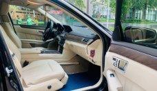 Cần bán lại xe Mercedes E200 đời 2015, màu kem giá 1 tỷ 270 tr tại Tp.HCM