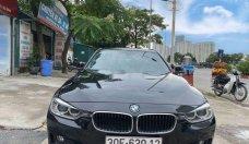 Bán xe BMW 3 Series 320i đời 2014, màu đen giá 810 triệu tại Hà Nội