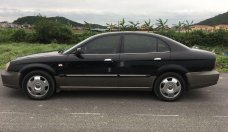 Cần bán xe Daewoo Magnus đời 2004, màu đen giá cạnh tranh giá 110 triệu tại Hà Nội